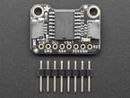 """Top view of DS3231 Precision RTC above a piece of 0.1"""" 8-pin header."""