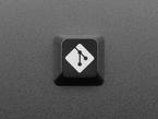 Top view of black GIT logo keycap.