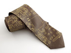Close up of olive colored tie with gold circuit board imagery