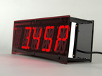 Angled shot of nightstand clock with large red digits