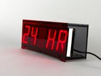 "Front of clock showing ""24 HR"" text on display"