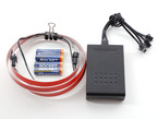 Kit shot of unlit red EL tape, inverter, and batteries.