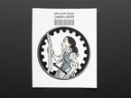 Circular sticker showing a cartoon of Ada Lovelace in profile, holding a crowbar and examining a long ruler, over a white background. Sticker is edged in black gear teeth. Mounted on white paper with barcode