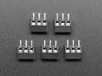 Top down view of five black 3-pin 3.5mm terminal blocks.