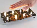 Hand waving over 2x4 warm white LED grid
