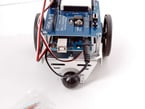 Front of robot showing Arduino  UNO and robotic shield attached.