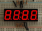 Red 7-segment clock display with all segments lit