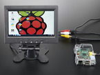 Enclosed TFT Television wired up to Raspberry Pi, showing off desktop screen.