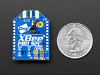 Top of XBee PRO S2C wireless module next to US Quarter.