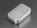 Common-size hinged mint tin case, closed.