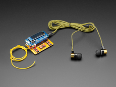 Angled shot of radio kit with black earbuds.
