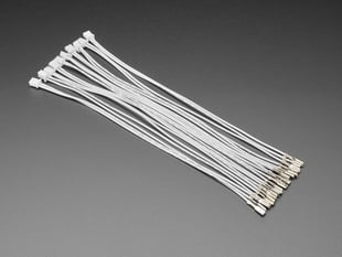 Angled shot of ten 20 cm long quick-connect wire pairs.