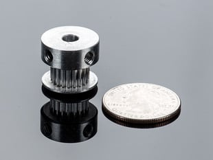 Aluminum Timing Pulley next to quarter