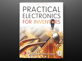 "Front cover of ""Practical Electronics for Inventors, Fourth Edition"". Covert art is a detailed close-up of a chip being placed on a circuit board."