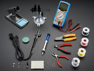 Collection of many electronic hand tools and soldering equipment
