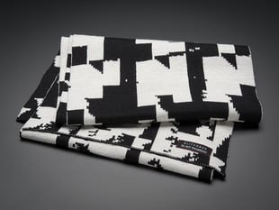 Folded black and white scarf with glitch design