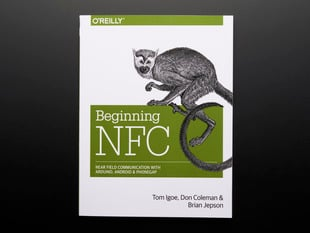 "Front cover of ""Beginning NFC with Arduino, Android, and PhoneGap"" Cover features a white-faced, long-tailed primate."