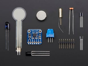 Kit components showing various sensors, LED, magnet and some header