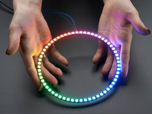 Hand holding NeoPixel Ring with 60   x 5050 RGB LED, lit up rainbow