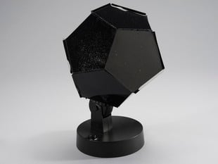 Black dodecahedron siting on a stand