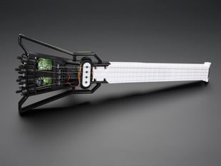 Angled shot of assembled Mini Electric Guitar Kit.