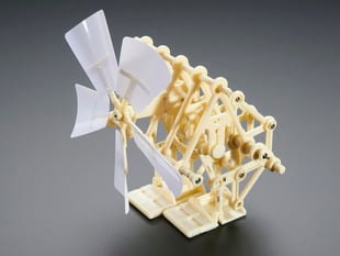 Angled shot of assembled biped mini kinetic sculpture kit.