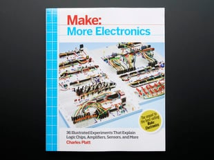 "Front cover of ""Make: More Electronics"" by Charles Platt. Cover photograph features multiple breadboards with highly intricate wirings."