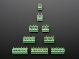 Top view of a pyramid of green terminal blocks of various sizes.