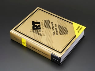 "Angled shot of hardcover ""The Art of Electronics 3rd Edition"" by Horowitz & Hill"