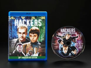 """DVD cover of 1995 film """"Hackers"""" next to the DVD disc."""