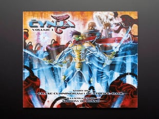 "Front cover of ""The Cynja: Volume 1"" by Chase Cunningham and Heather Dahl and illustrated by Shirow de Rosso. A powerful cyber-warrior wields two swords amid a a chaoic, warlike background."