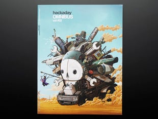 "Front cover of ""Hackaday Omnibus - Vol. 02 - 2015"" Art illustration is of a Mad Max-like vehicular contraption with the skull Hackaday logo."