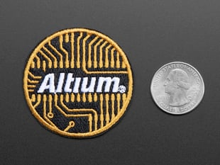 Circular embroidered badge with the word Altium in white over an abstracted orange circuit board design on a black background, with orange trim.