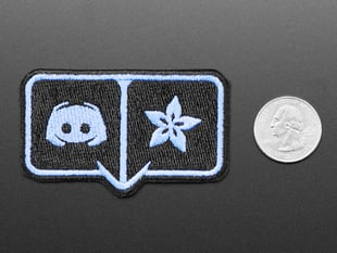 Rectangularish embroidered badge with Discord and Adafruit flower logos in light blue over a black background, outlined in light blue.