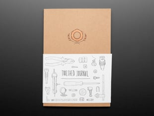 Front cover of Toolshed Journal with slipcover featuring many tool drawings