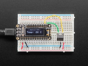 TC74A0 Breadboard Friendly I2C Temperature Sensor plugged into breadboard wired to Feather displaying the temperature