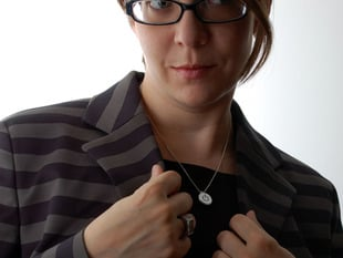 Woman wearing metal necklace with power button icon