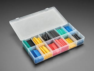 Opened box full of short lengths of multi color heat shrink