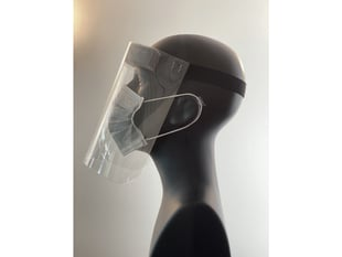 Side profile of the face shield on a mannequin head. Shield starts at the forehead and ends below the chin