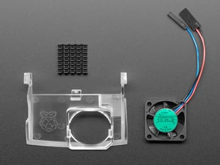 Kit contents showing plastic insert, fan, and heat sink