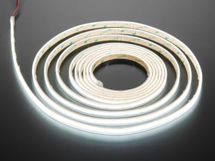 Long coiled LED strip lit up cool white