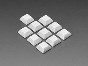 Angled shot of 10 gray plastic keycaps.