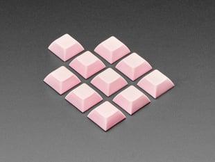 Angled shot of 10 pink plastic keycaps.