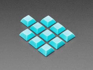 Angled shot of 10 Light Blue plastic keycaps.