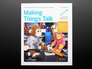 "Front cover of ""Making Things Talk, Second Edition"" By Tom Igoe - 2nd Edition. Cover photograph features two different stuffed monkey toys tinkering with electronics."