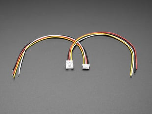 Angled shot of two 2.0mm pitch 4-pin JST PH matching cable pairs. The cables are not connected.