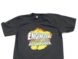 "dark grey t-shirt with an image of an explosion and text that says ""engineering it's like math but louder"""