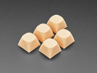 Angled shot of five cream orange MA keycaps.