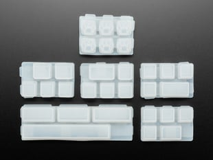 Top view of six different keycap mold sets.