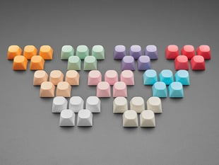 Angled shot of 9 5-packs of different colored MA keycaps.
